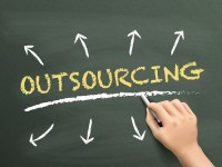 outsourcing word written by hand over chalkboard